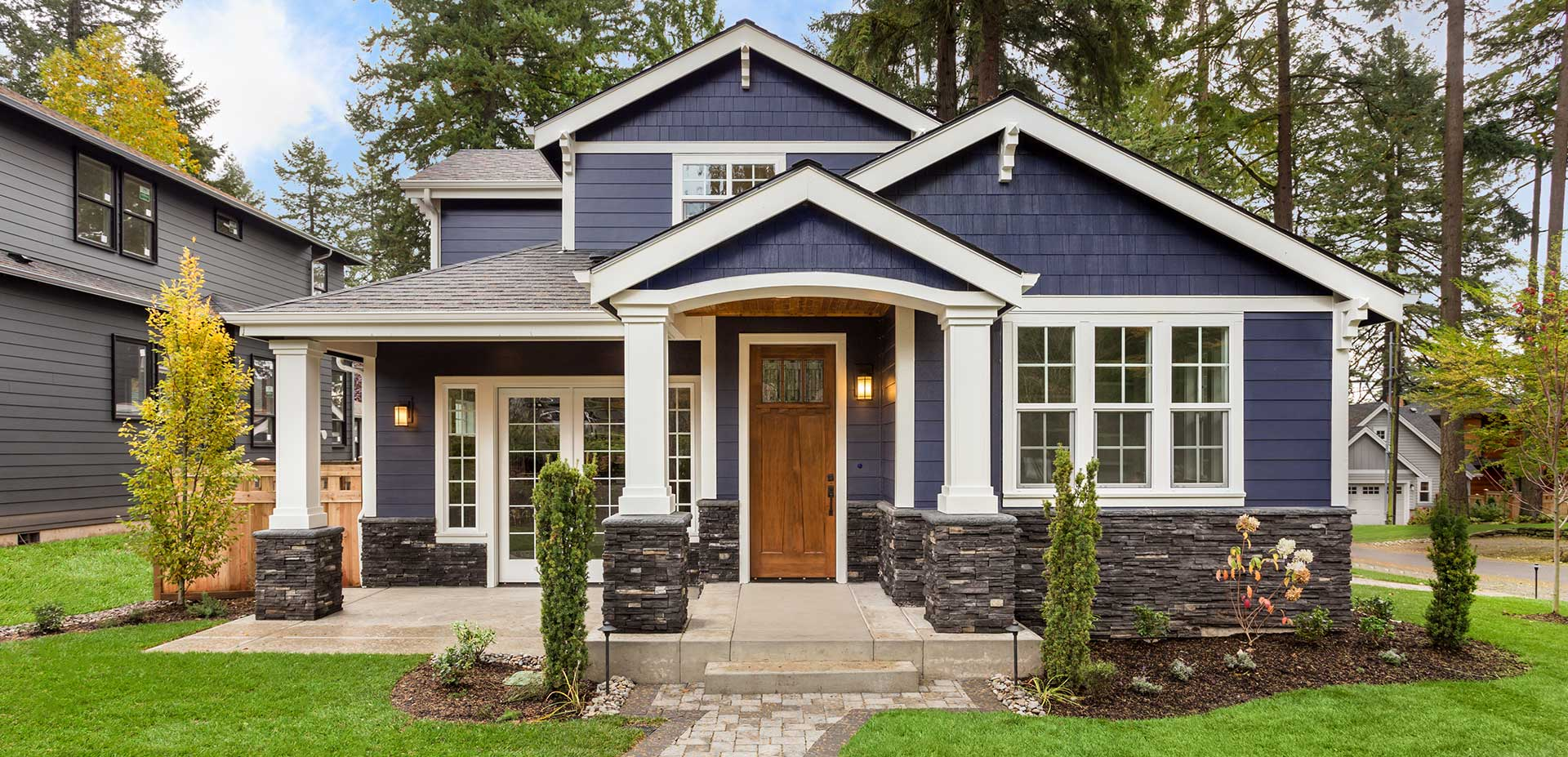 Beautiful Home front with tasteful blue siding.