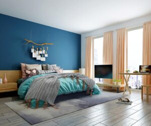 bedroom with one wall painted royal blue and other painted white.